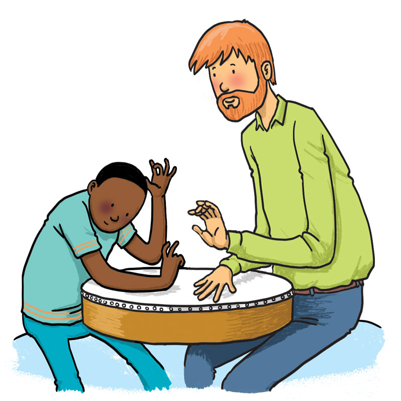 man plays a drum with a boy