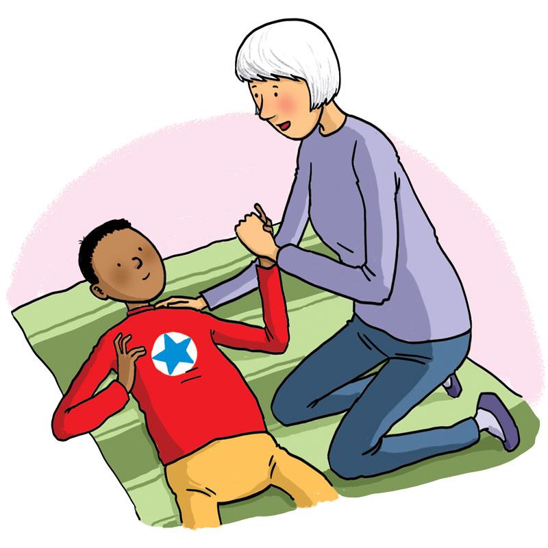 Lady helps a boy on a mat listening