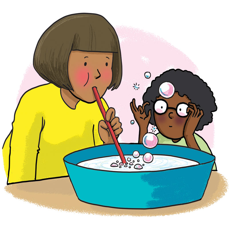 Woman blows bubbles in a bowl of water