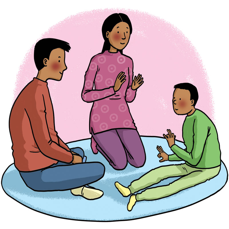 three people sat in a circle playing sounds games