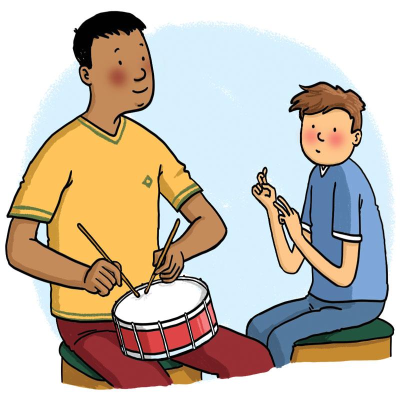 man plays drum for a boy