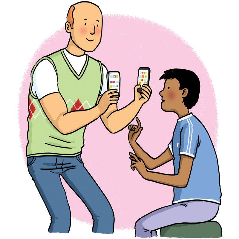 man holds phones playing ringtones for a boy