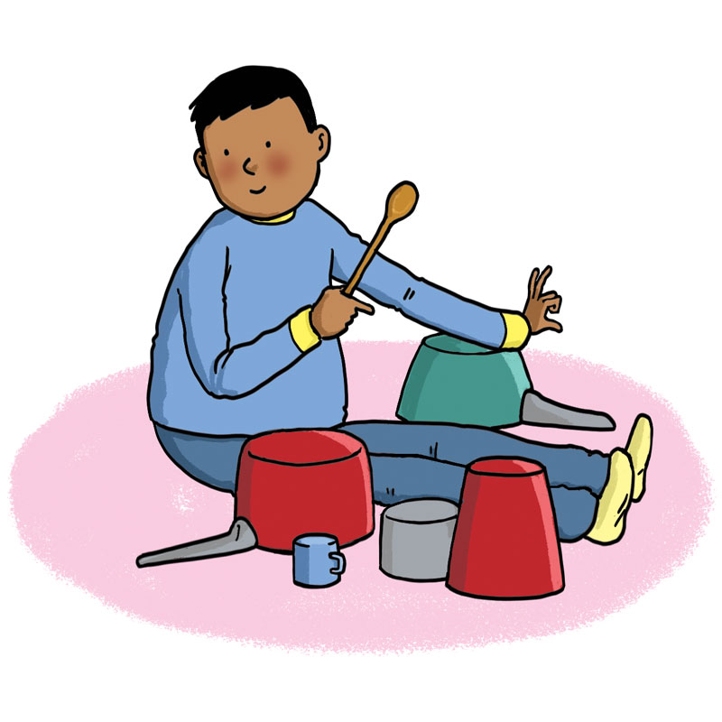 boy making sounds on pots and pans