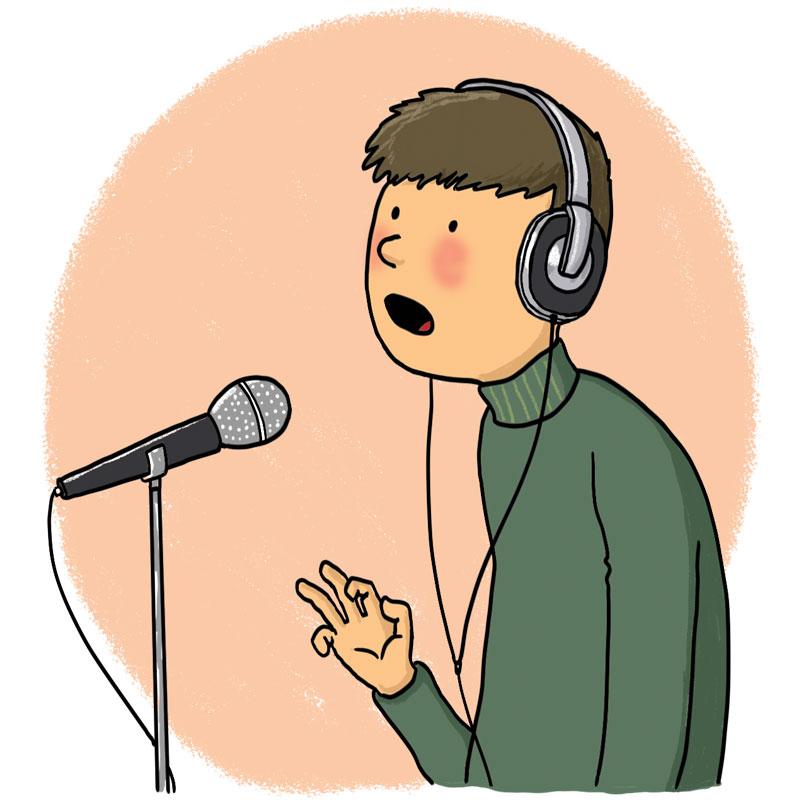 boy sings into a mic