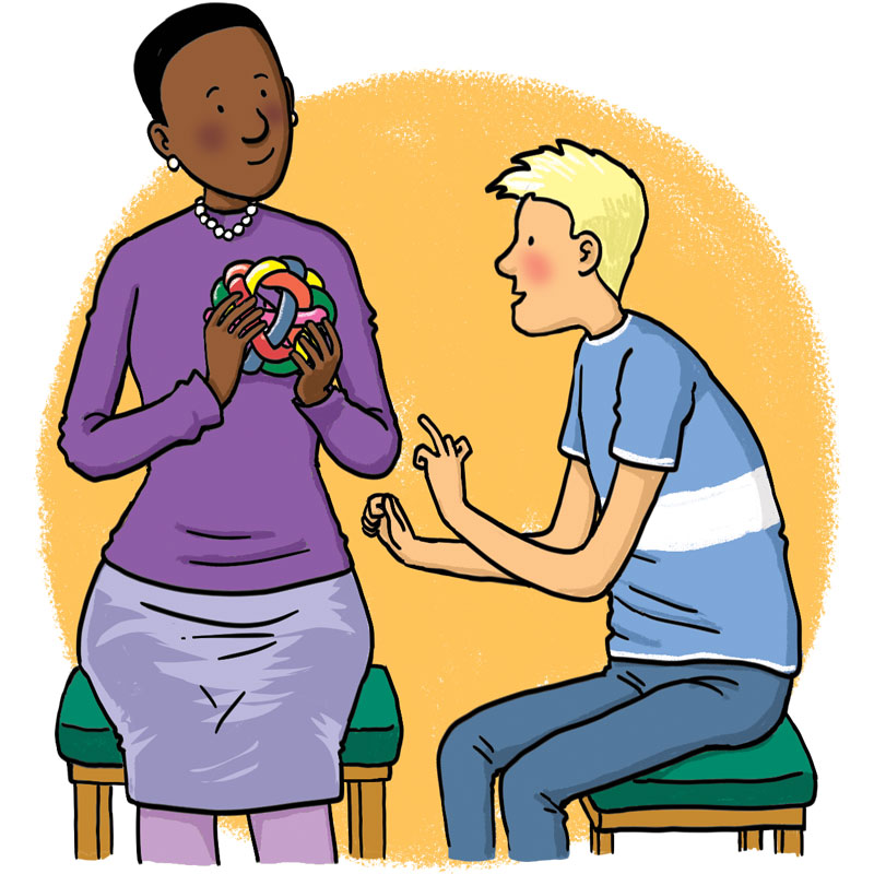 Woman shows a toy to a boy